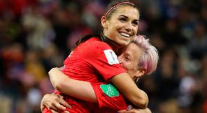 Alex Morgan celebrates with Megan Rapinoe after scoring the USA's 12th goal against Thailand. Photo: Getty