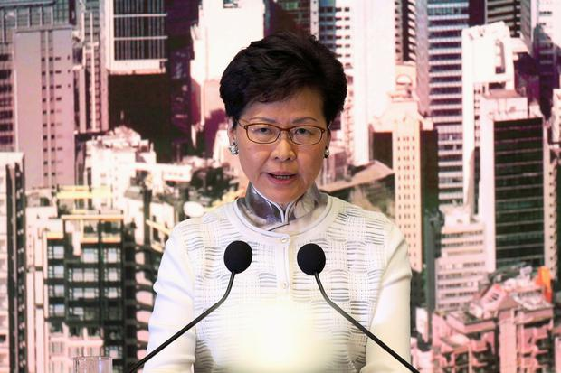 On the way out: Hong Kong chief executive Carrie Lam. Photo: REUTERS/Athit Perawongmetha