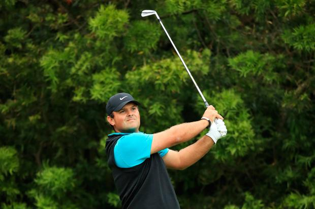 Patrick Reed plays a shot from the 12th tee. Photo: Getty
