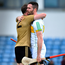 Kerry's Patrick Kelly consoles Offaly's James Gorman after yesterday's Joe McDonagh Cup match at Austin Stack Park. Photo: Brendan Moran