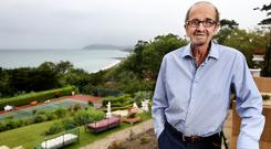 ENTREPRENEUR WITH DRIVING AMBITION: Louis Murray, who despite a tough upbringing has led a successful life, at his stunning home on Killiney Hill. Photo: Steve Humphrey