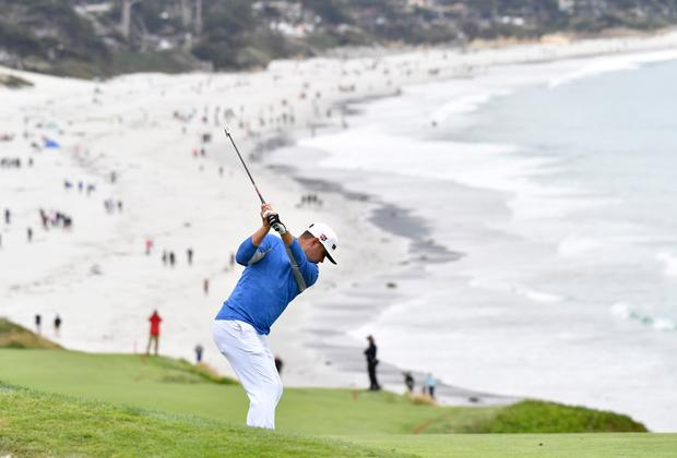 Gary Woodland hits from the fairway on the 9th hole during the third round of the 2019 US Open at Pebble Beach
