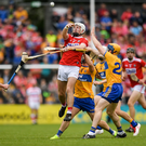 Luke Meade of Cork in action against Seadna Morey of Clare during the Munster GAA Hurling Senior Championship Round 5 match between Clare and Cork at Cusack Park in Ennis, Clare. Photo by Eóin Noonan/Sportsfile