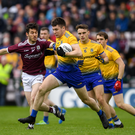 Conor Daly of Roscommon in action against Ian Burke of Galway during the Connacht GAA Football Senior Championship Final match between Galway and Roscommon at Pearse Stadium in Galway. Photo by Ramsey Cardy/Sportsfile
