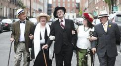 (L-r) Donal and Suzanne Thurlow from Limerick and Dermot McElwaine and Caroline Coyle from Athlone arriving at The James Joyce Centre greeted by James Joyce Picture Conor McCabe Photography.
