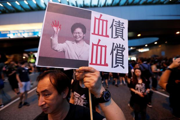 A protester holds a placard depicting Hong Kong Chief Executive Carrie Lam during a demonstration demanding Hong Kong's leaders to step down and withdraw the extradition bill REUTERS/Jorge Silva
