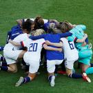 Allie Long of the U.S. and team mates form a huddle on the pitch after the match REUTERS/Gonzalo Fuentes