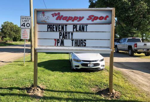 A sign at The Happy Spot restaurant in Deer Grove, Illinois, U.S., June 13, 2019. Picture taken June 13, 2019. REUTERS/Tom Polansek