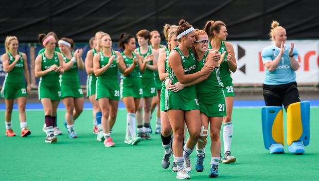Elena Tice consoles Zoe Wilson after final defeat to South Korea. Photo: Oliver McVeigh/Sportsfile