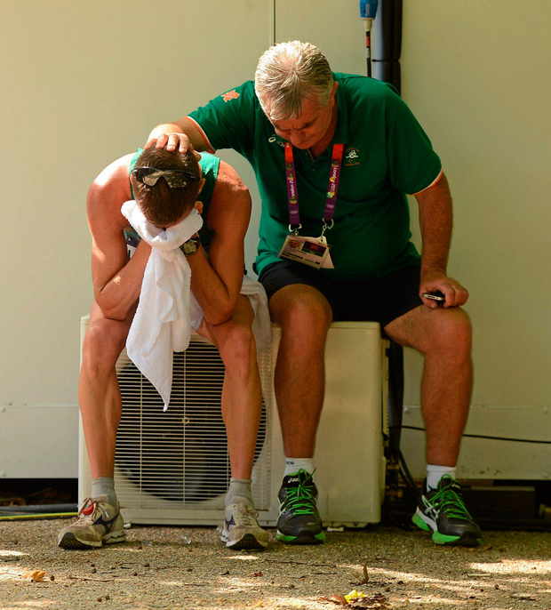 McGonagle consoles Robert Heffernan after his fourth-place finish in the 50km race walk in London 2012. Photo: Stephen McCarthy / SPORTSFILE