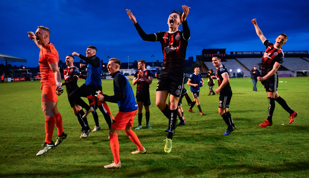 Andy Lyons (centre) jumps for joy with his Bohemians team-mates after Friday night's 2-1 derby victory against Shamrock Rovers. Photo: Seb Daly/Sportsfile