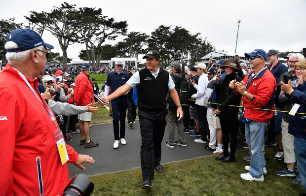 Centre of attention: Phil Mickelson greets supporters during the third round of the US Open at Pebble Beach Golf Links. Photo: Michael Madrid-USA TODAY Sports