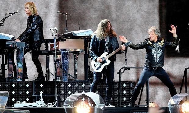 Singer Jon Bon Jovi, Phil X on Guitar and David Bryan on Keyboards performing on stage at the RDS. Photo: Steve Humphreys