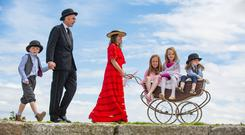 Enjoying a walk along Dún Laoghaire pier during the Bloomsday Coastal Festival were Sandymount siblings Bronwyn (8) and Macdara (3) Boyd and cousin Lilah Maher (7), with their parents, Stephen and Mary Boyd, and Cameron Boyd (6). Photo: Mark Condren