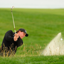 ONE THAT GOT AWAY: Phil Mickelson plays a shot from a bunker on the 11th hole at Pebble Beach, California. Photo: Ross Kinnaird/Getty Images