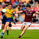 Enda Smith of Roscommon in action against John Daly of Galway. Photo: Ramsey Cardy/Sportsfile