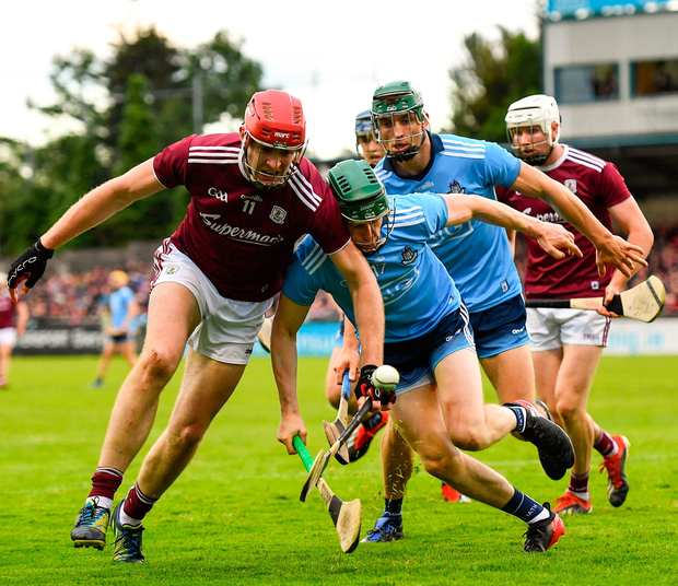 James Madden of Dublin in action against Jonathan Glynn of Galway. Photo: Ramsey Cardy/Sportsfile