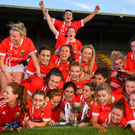 Cork players celebrate with the trophy following the TG4 Ladies Munster SFC final victory against Waterford at Fraher Field. Photo: Harry Murphy/Sportsfile