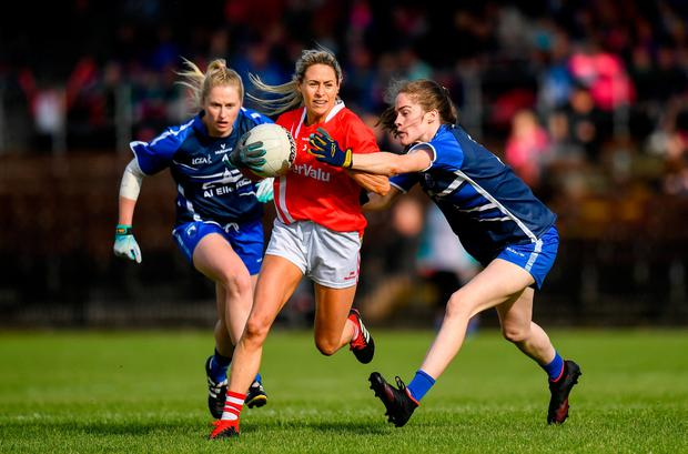 Orla Finn of Cork in action against Emma Murray, right, and Máiréad Wall of Waterford. Photo: Harry Murphy/Sportsfile