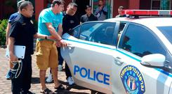 Italian national Francesco Galdelli (C) after he was arrested on the outskirts of Pattaya.