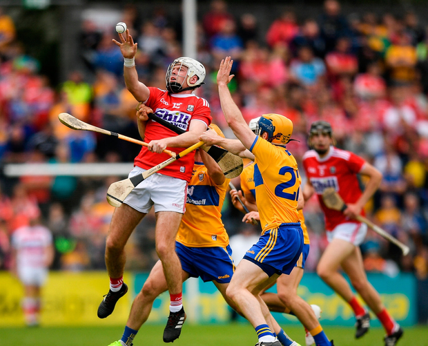Luke Meade of Cork in action against Seadna Morey of Clare