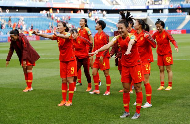 China's Haiyan Wu, Li Yang and team mates celebrate in front of their fans after the Women's World Cup Group B draw with Spain in Le Havre, France. Photo: REUTERS/Phil Noble