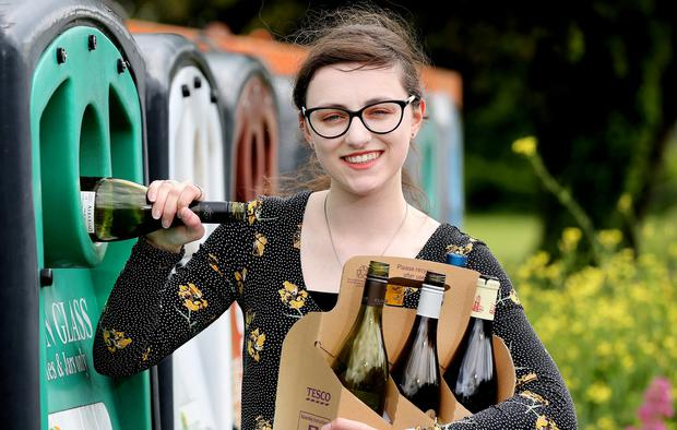 Doing it right: Reporter Aine Kenny recycling her bottles in Sandymount, Dublin. Photo: Steve Humphreys