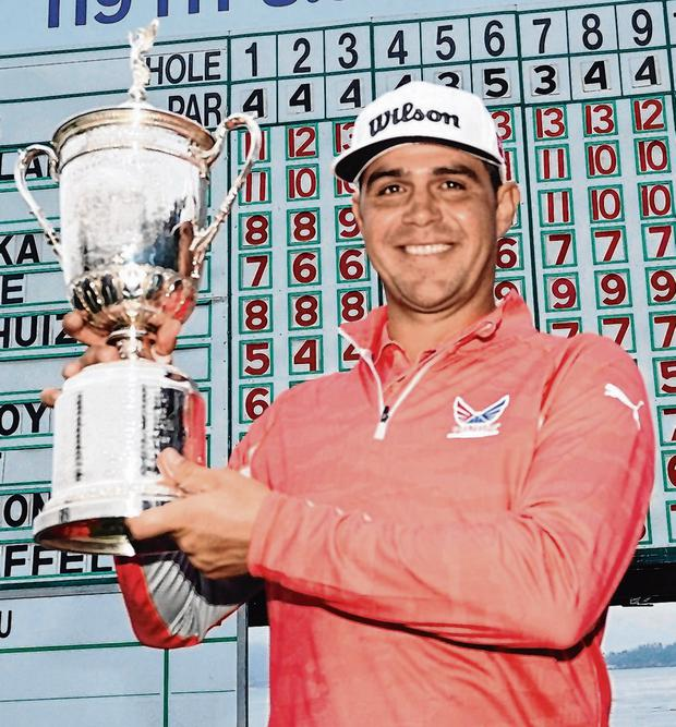 Gary Woodland shows off the US Open trophy after his three-shot victory at Pebble Beach. Photo: David J. Phillip/AP Photo