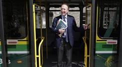 On the buses: Transport Minister Shane Ross arrives on a hybrid Dublin bus for the launch of the Climate Action Plan. Photo: Damien Eagers/INM