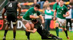 Ireland's Michael Milne is tackled by Aaron Hinkley of England during their fifth place play-off. Photo: Florencia Tan Jun/Sportsfile