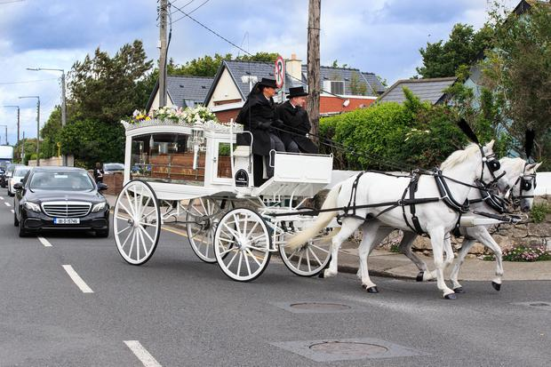Funeral: The coffin of Philomena Lynott is brought to St Finian's Church Sutton. Photo: Mark Condren