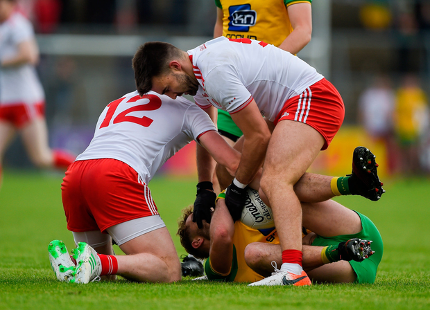 Tiernan McCann of Tyrone interferes with Stephen McMenamin of Donegal. Photo by Daire Brennan/Sportsfile