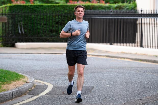 Morning run: Second-favourite candidate Jeremy Hunt. Photo: Leon Neal/Getty Images