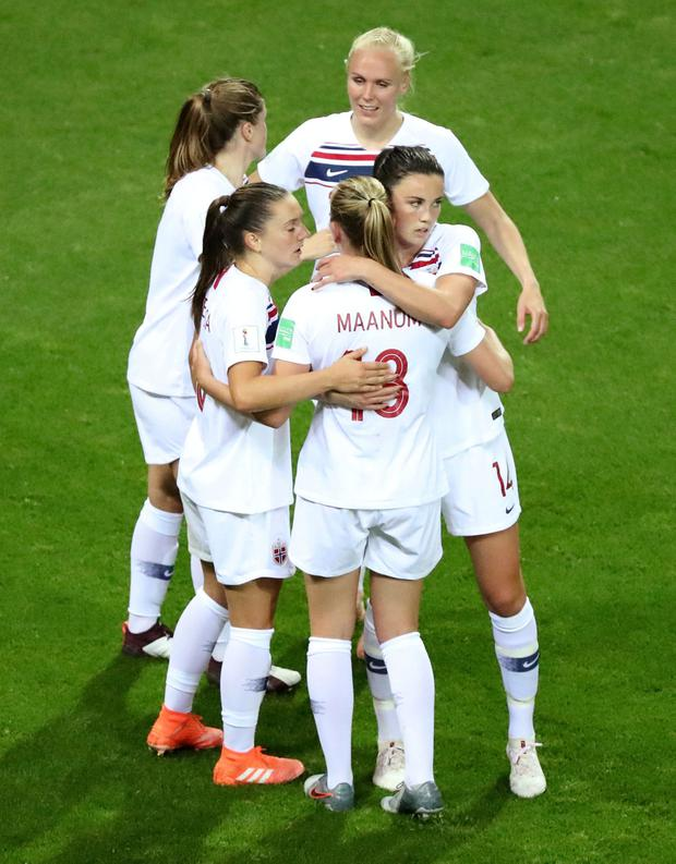 Soccer Football - Women's World Cup - Group A - Korea Republic v Norway - Stade Auguste-Delaune, Reims, France - June 17, 2019 Norway's Ingrid Syrstad Engen celebrates with Frida Maanum and team mates at the end of the match REUTERS/Lucy Nicholson