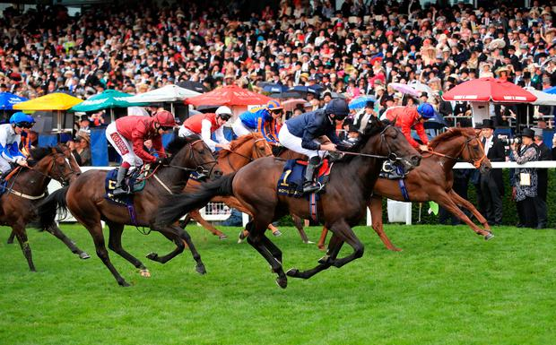 Arizona ridden by jockey Ryan Moore (second right) on his way to winning the Coventry Stakes during day one of Royal Ascot at Ascot Racecourse. Photo: Adam Davy/PA Wire