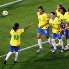 Brazil's Marta celebrates scoring their first goal with her team-mates in the Women's World Cup Group C clash in Valenciennes, France . Photo: REUTERS/Bernadett Szabo