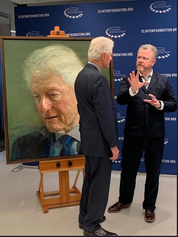 Artist and subject: Colin Davidson talks to Bill Clinton at the unveiling of his portrait in New York