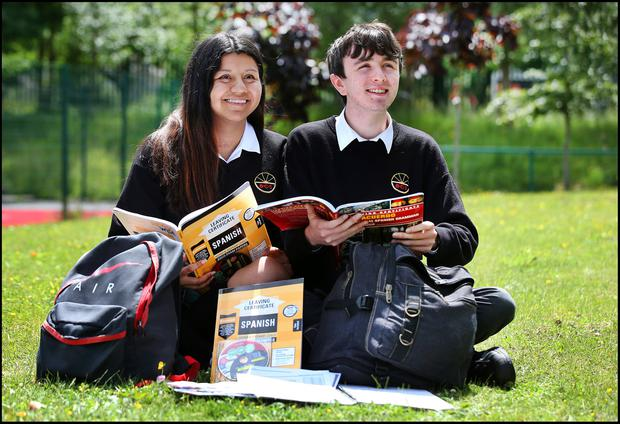 Sunny outlook: Lina Amri, from Dundrum, and Joel Amador, from Tallaght, after sitting the Leaving Cert Spanish exam at Ballinteer Community School in south Dublin. Photos: Steve Humphreys
