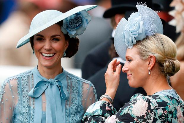 Britain's Catherine, Duchess of Cambridge, (L) and Zara Phillips (R) attend on day one of the Royal Ascot horse racing meet, in Ascot, west of London, on June 18, 2019