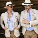 Gentlemen, wearing light color suits and straw hats, are seen during Pitti Immagine Uomo 96 on June 12, 2019 in Florence, Italy. (Photo by Claudio Lavenia/Getty Images)
