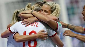 England's scorer Ellen White, front, and her team-mates celebrate the opening goal during the Women's World Cup Group D match at the Stade de Nice, France. (AP Photo/Claude Paris)