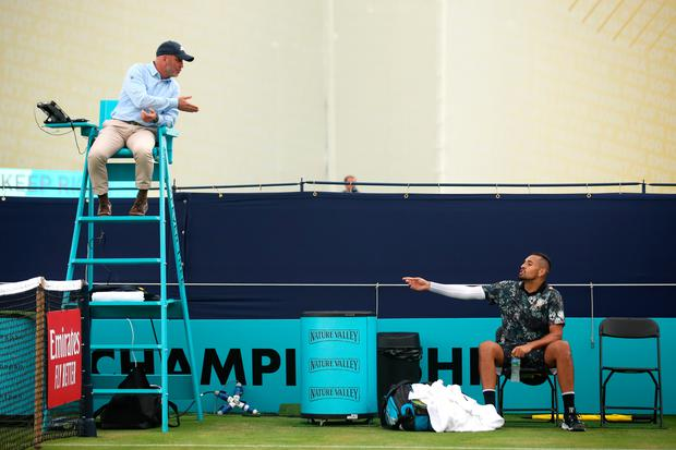 Nick Kyrgios of Australia complains to the umpire Fergus Murphy of Ireland during his First Round Singles Match against Roberto Carballes Baena of Spain during day four of the Fever-Tree Championships at Queens Clubin London. (Photo by Alex Pantling/Getty Images)