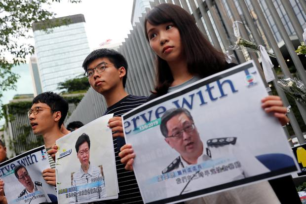 Nathan Law, Joshua Wong and Agnes Chow attend a news conference on the proposed extradition bill, near the Legislative Council building in Hong Kong. Photo: REUTERS/Tyrone Siu