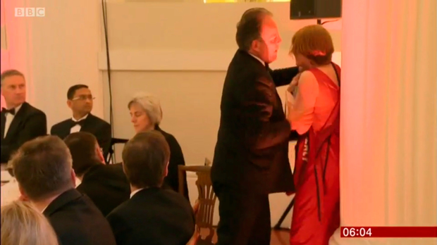 Video grab taken from the BBC of Foreign Office Minister Mark Field showing him physically removing a climate change protester Photo credit: BBC/PA Wire