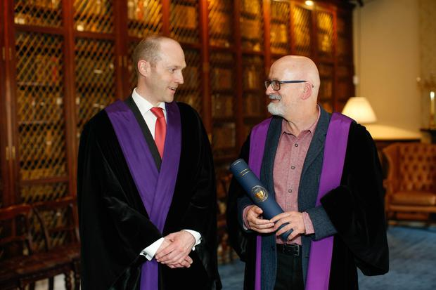 Roddy Doyle with Professor Brendan Kelly, pictured at the Royal College of Physicians of Ireland Photo: Kenneth O Halloran