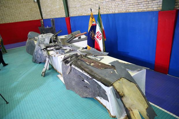 Wreckage: The Islamic Revolution Guards Corps displays what it says are the remains of the US drone shot down by an Iranian missle. Picture: Reuters