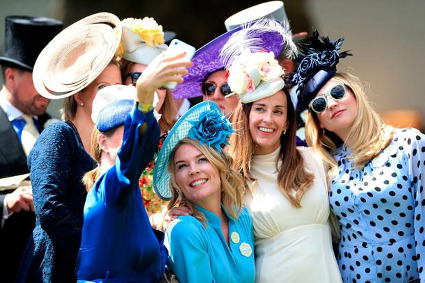 Autumn Phillips (second left) poses for a picture with racegoers during day five of Royal Ascot at Ascot Racecourse. PRESS ASSOCIATION Photo. Picture date: Saturday June 22, 2019. See PA story RACING Ascot. Photo credit should read: Mike Egerton/PA Wire. RESTRICTIONS: Use subject to restrictions. Editorial use only, no commercial or promotional use. No private sales.