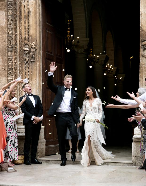 at their wedding in Puglia, Italy. Picture: Alli Woods