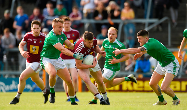 Ger Egan of Westmeath in action against Gordon Brown, left, and Iain Corbett of Limerick
