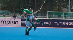 Neal Glassey and Sean Murray celebrate the fourth and winning goal as Ireland reached today's final